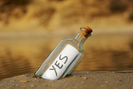 Yes, bottle on the beach Stock Photo