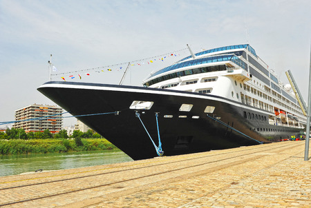 Cruise ship luxury in port of Seville, river Guadalquivir, Spain