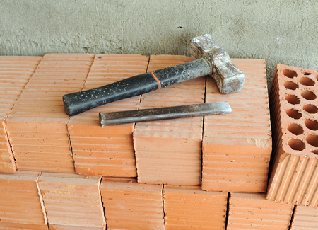 Hammer and chisel, tools of a bricklayer Stock Photo