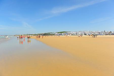 walking in Bateles beach, Conil de la Frontera, coast of Cadiz, Andalusia, Spain