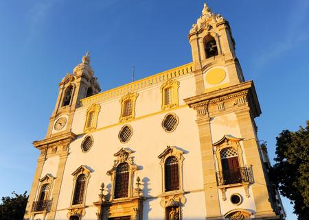 Baroque Carmo Church (Igreja do Carmo) in Largo do Carmo at sunset, Faro, Algarve region in southern Portugal, Europe