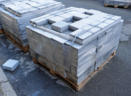 Granite blocks prepared for the paving of a pedestrian street Stock Photo