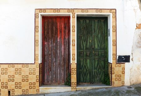 House of popular architecture with two wooden doors in a humble neighborhood of a Spanish town