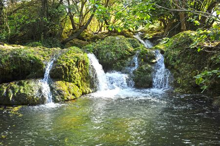 Natural Park Sierra Norte of Seville. Waterfall of Hueznar near the village of San Nicolas del Puerto, Seville province, Andalusia, Spain