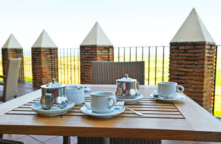Cups of coffee and tea infusions on a terrace of a hotel in Carmona, Seville province, Andalusia, Spain