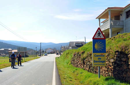 Pilgrims arriving to Laza town on the Camino de Santiago, Camino Sanabres from Campobecerros to Laza, Orense province, Spain