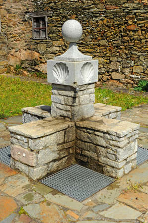 Drinking water source in village of As Eiras on the Camino de Santiago towards the city of Laza, Orense province, Spain Standard-Bild