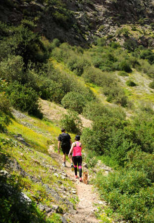 Couple hikers in the Guadiaro river near the Canyon of the Buitreras