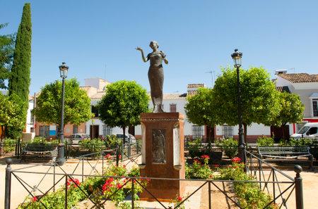 Plaza Nueva and monument to La Nina de la Puebla, a famous flamenco singer, in La Puebla de Cazalla, province of Seville, Andalusia, Spain Editorial