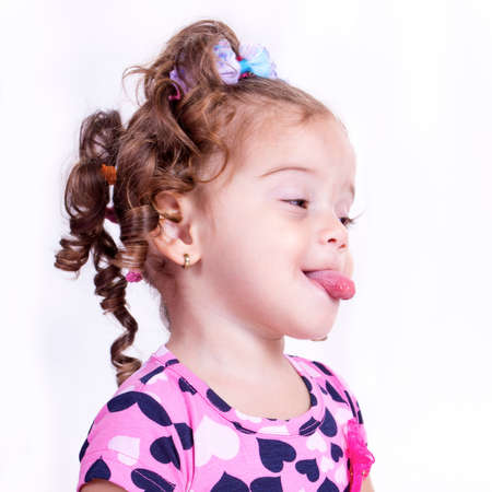 sticking out tongue: Girl sticking out tongue Stock Photo