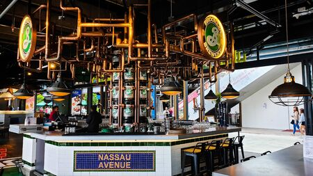 Pahang / Malaysia - July 1, 2019: Interior of the coolest drinking bar counter in High Line Roof Top Market at Sky Avenue Genting Highlands 写真素材 - 129868416