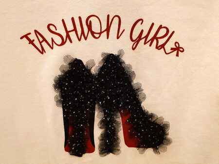 Handmade fashion art work with printing of fashion girl slogan and black high heel stitched with black lace and embellishments Foto de archivo - 129914534