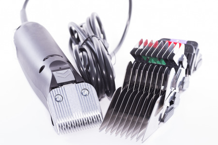 combs: Trimmer machine and combs.