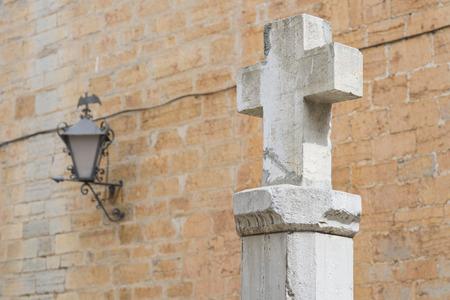 the believer: Stone cross. Stock Photo