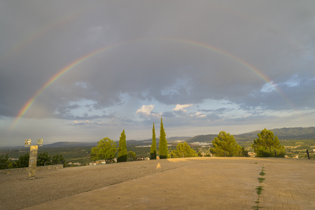 drizzling rain: Rainbow. Stock Photo