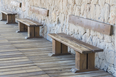 public works: Wooden benches. Stock Photo