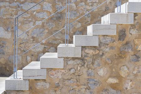 downstairs: Stone stairs. Stock Photo