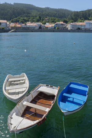 dinghies: Small boats.
