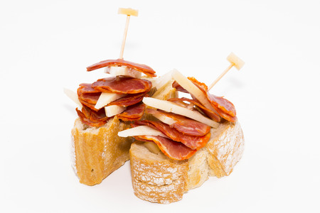 Skewer of Iberian cured loin with cheese. Stock Photo