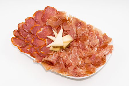 Iberian table Ham, loin and cheese. Stock Photo
