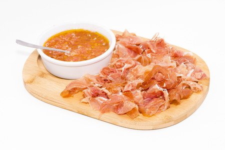 iberian: Table of iberian ham and grated tomato.