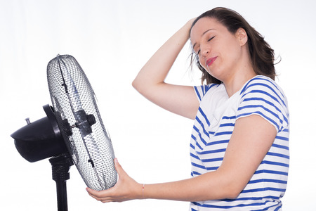 airflow: Girl and fan.