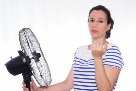 caribbean climate: Girl and fan.