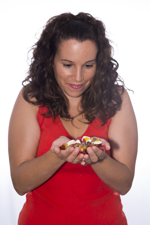 childrens food: Girl eating candies.