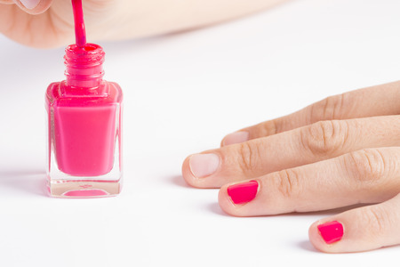 to polish: Nail polish. Stock Photo