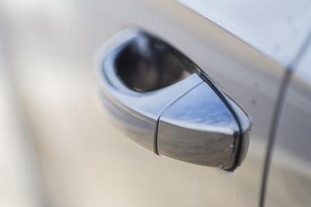 door handle: Door handle of a car.