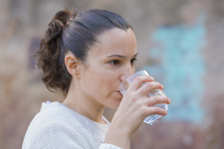 swallowing: Girl drinking water.