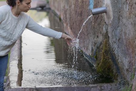 water sanitation: Girl washing glass.