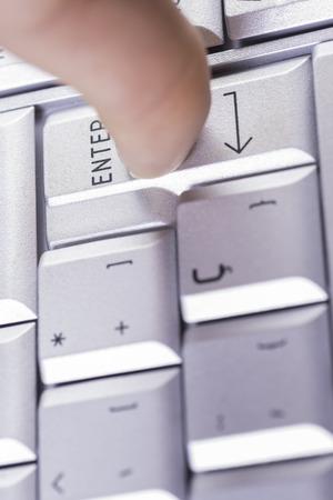 terminate: Pressing ENTER key. Stock Photo