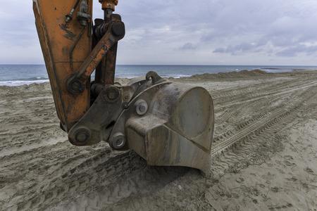 mechanical works: Bulldozer on the beach.