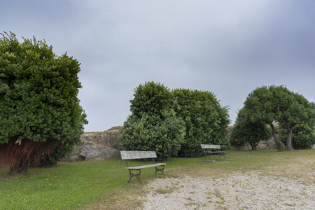 bens: Wooden benches in park of Bens (La Coruna, Spain).
