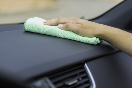 microfiber: Cleaning interior of  a car. Stock Photo