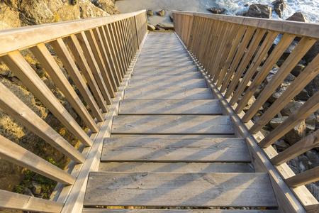 Wooden stairs in Caion beach (La Coruna, Spain)