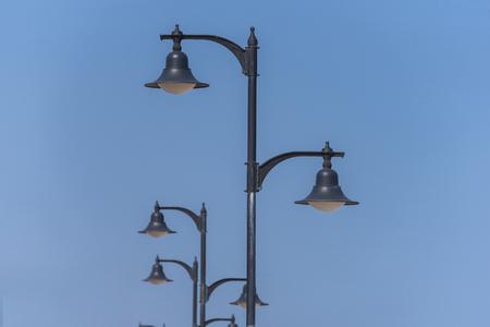 Street lights in a row. Фото со стока