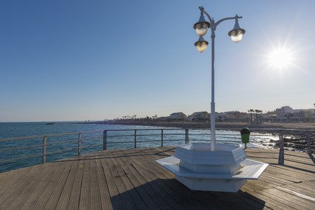 Wooden footbridge and street light in Chilches (Castellon, Spain). Фото со стока