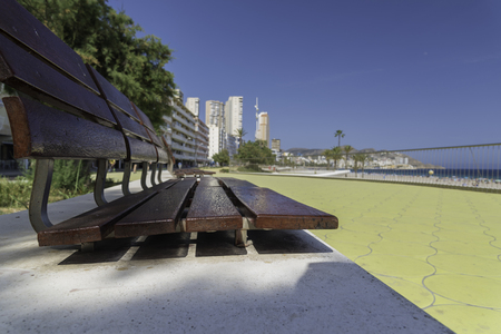 Wooden bench in Benidorm (Alicante, Spain).