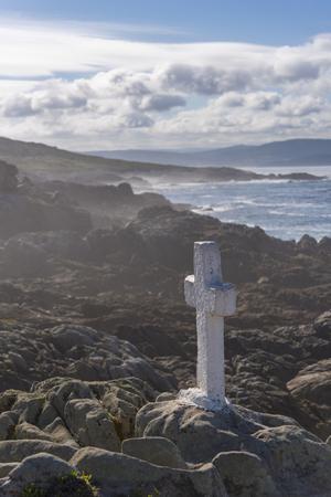 Stone cross in Costa da Morte (La Coruna, Spain). Stock Photo - 91436255