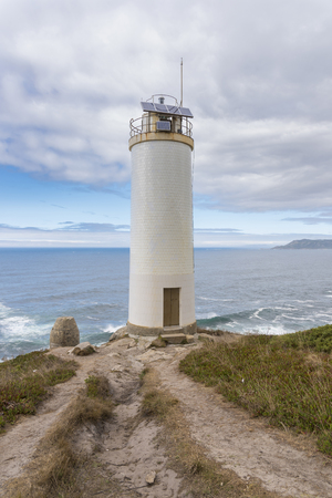 Laxe lighthouse (La Coruna, Spain). Stock Photo