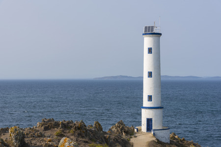 Lighthouse of Cabo Home (Cangas, Pontevedra - Spain). Stock Photo