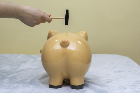 Breaking a piggy bank.
