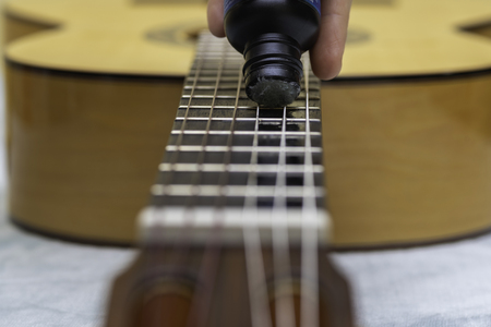 Cleaning of guitar strings.