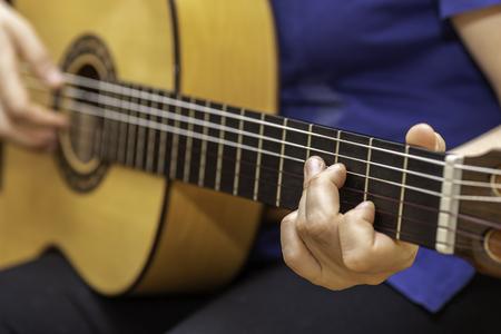 Playing spanish guitar. Stock Photo