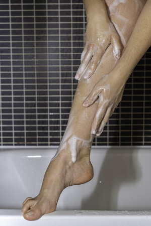 Leg of a girl in the shower.