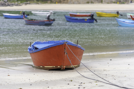 Boat moored on the beach.