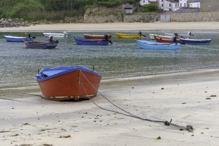 Boat morred on the beach.