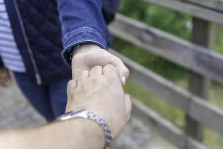 Couple holding hands. Stock fotó